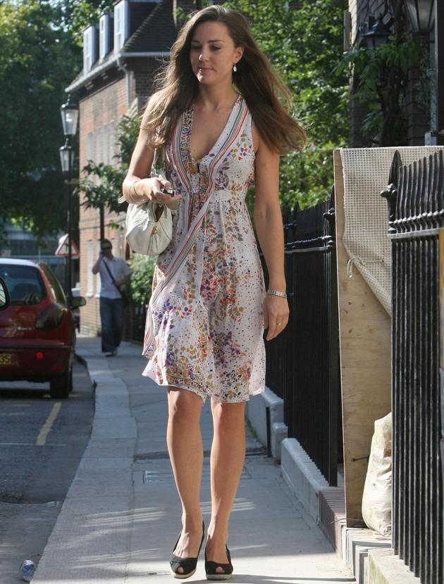 Kate Middleton photos: If there'd been a gust of wind on this summer's day this picture could have had a very different caption… Thankfully the Duchess' modesty remained intact! This floaty frock is just the ticket for a summer's picnic. Pimms anyone?
