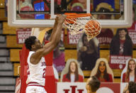 Indiana forward Jordan Geronimo (22) scores with a slam dunk during the first half of an NCAA college basketball game against Iowa, Sunday, Feb. 7, 2021, in Bloomington, Ind. (AP Photo/Doug McSchooler)