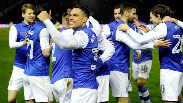 Derby County slipped up in their promotion chase against Sheffield Wednesday as Cardiff City saw off Bolton Wanderers.