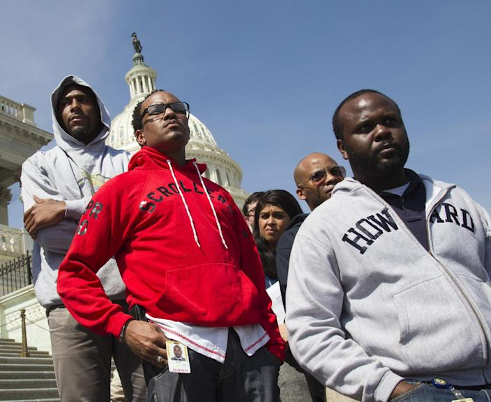 "Congressional staff members and others join in the ""Hoodies on the Hill"" gathering on Capitol Hill in Washington, Friday, March 23, 2012 to remember Trayvon Martin, the unarmed black teenager who was shot in Sanford, Fla. (AP Photo/J. Scott Applewhite)"