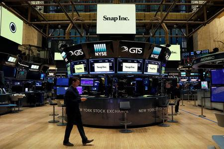 Snap Inc. logos are seen on the floor of the New York Stock Exchange (NYSE) on the eve of the company's IPO in New York, U.S., March 1, 2017. REUTERS/Brendan McDermid