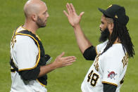 Pittsburgh Pirates relief pitcher Richard Rodriguez (48) celebrates with catcher Jacob Stallings after getting the final out of a baseball game against the Chicago White Sox in Pittsburgh, Tuesday, June 22, 2021. The Pirates won 6-3. (AP Photo/Gene J. Puskar)
