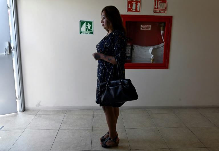 A transgender woman waits at Mexico City's Condesa Clinic, which specializes in HIV and provides free treatment for both Mexicans and migrants