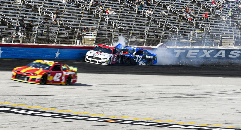 Brad Keselowski (2) and and Ricky Stenhouse Jr. (17) collide during a NASCAR auto race at Texas Motor Speedway, Sunday, Nov. 3, 2019, in Fort Worth, Texas. (AP Photo/Randy Holt)