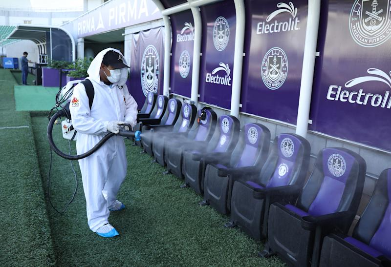 MAZATLAN, MEXICO - SEPTEMBER 18: A member of the cleaning team sanitizes the benches as part of the Covid-19 protocol prior the 11th round match between Mazatlan FC and Cruz Azul as part of the Torneo Guard1anes 2020 Liga MX at Kraken Stadium on September 18, 2020 in Mazatlan, Mexico. (Photo by Sergio Mejia/Getty Images)