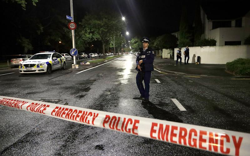 "A police officer patrols at a cordon near a mosque in central Christchurch, New Zealand, Friday, March 15, 2019. Multiple people were killed in mass shootings at two mosques full of worshippers attending Friday prayers on what the prime minister called ""one of New Zealand's darkest days,"" as authorities detained four people and defused explosive devices in what appeared to be a carefully planned attack."