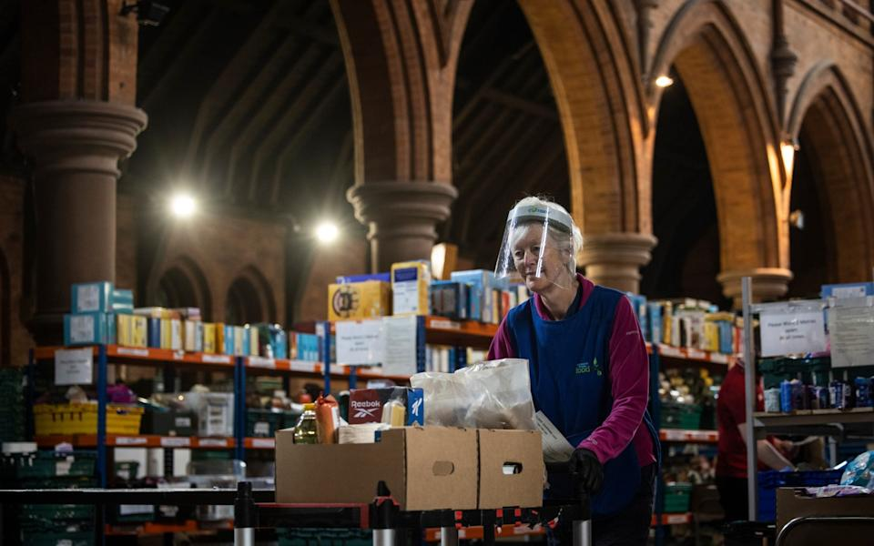 Staff and volunteers pack and prepare food parcels at the South London warehouse and distribution centre at St Margaret's Church - Getty