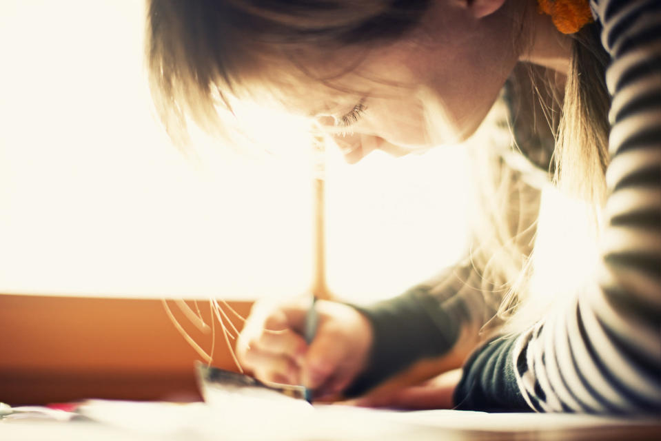 A 10-year-old girl who wrote a poem about dyslexia is winning fans online. (Photo: Getty Images)