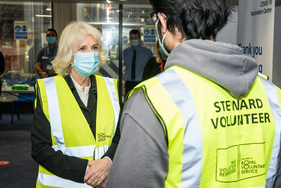 The Duchess of Cornwall, pictured during a visit to the Wembley Vaccination Centre, said she leapt in the air after her jab (Royal Voluntary Service/PA)