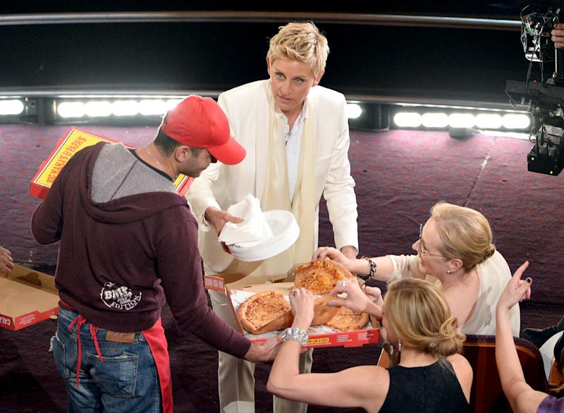Host Ellen DeGeneres onstage during the Oscars at the Dolby Theatre on March 2, 2014 hands out pizza