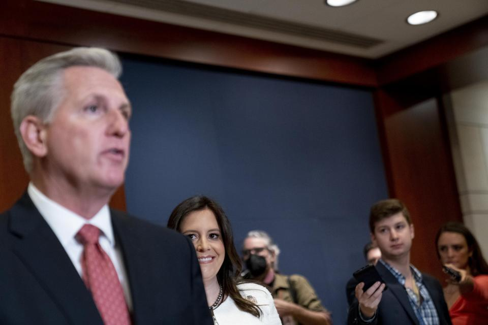 Newly-elected House Republican Conference Chair Rep. Elise Stefanik, R-N.Y., second from left, watches as House Minority Leader Kevin McCarthy of Calif., left, speaks to reporters at the Capitol in Washington, Friday, May 14, 2021. (AP Photo/Andrew Harnik)