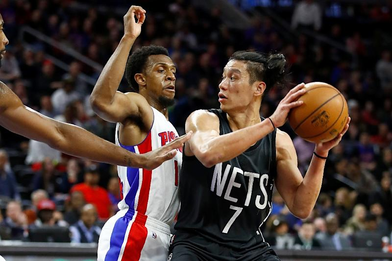 612bc7c186af Jeremy Lin of the Brooklyn Nets looks to pass around Ish Smith of the  Detroit Pistons