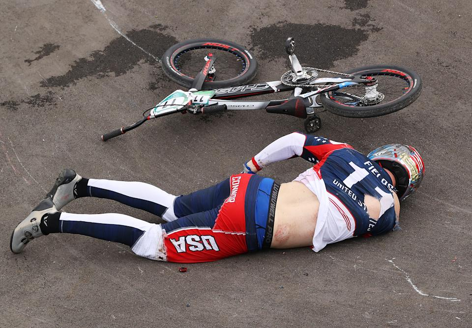 TOKYO, JAPAN - JULY 30: Connor Fields of Team United States goes down holding his hip after a crash during the Men's BMX semifinal heat 1, run 3 on day seven of the Tokyo 2020 Olympic Games at Ariake Urban Sports Park on July 30, 2021 in Tokyo, Japan. (Photo by Francois Nel/Getty Images)
