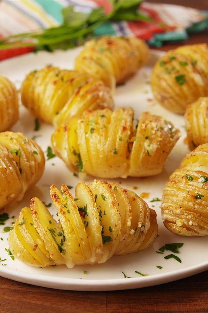 """<p>Hasselback it up into these potatoes.</p><p>Get the recipe from <a href=""""https://www.delish.com/cooking/recipe-ideas/recipes/a55051/garlic-butter-potatoes-recipe/"""" rel=""""nofollow noopener"""" target=""""_blank"""" data-ylk=""""slk:Delish"""" class=""""link rapid-noclick-resp"""">Delish</a>.</p>"""