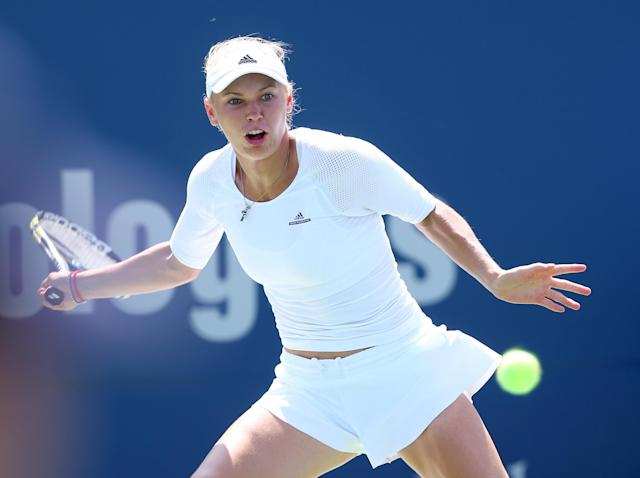 Caroline Wozniacki of Denmark returns a shot to Camila Giorgi of Italy during the Connecticut Open on August 20, 2014 in New Haven (AFP Photo/Elsa)