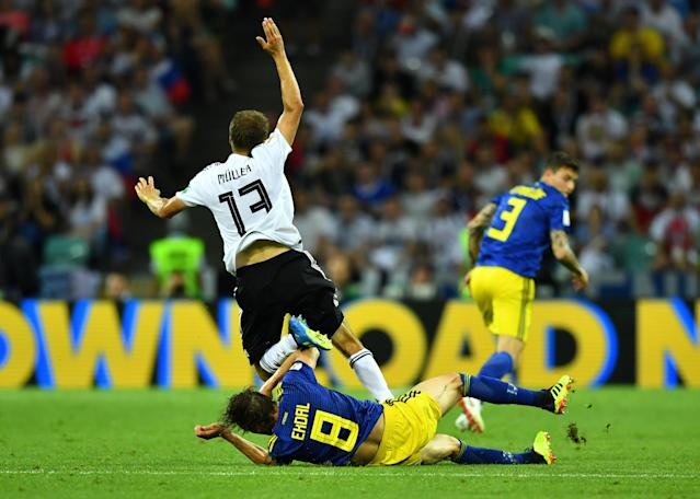Soccer Football - World Cup - Group F - Germany vs Sweden - Fisht Stadium, Sochi, Russia - June 23, 2018 Germany's Thomas Muller goes down after a challenge by Sweden's Albin Ekdal which subsequently led to a yellow card REUTERS/Dylan Martinez