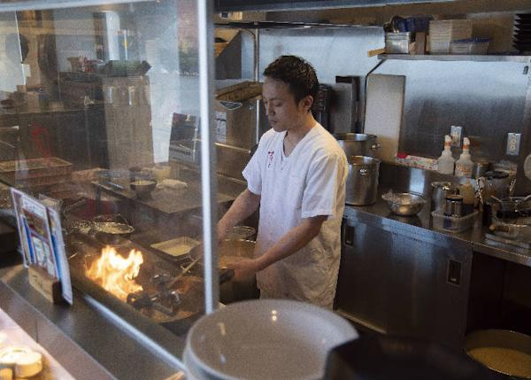 The flames help enhance the aroma in the wok.