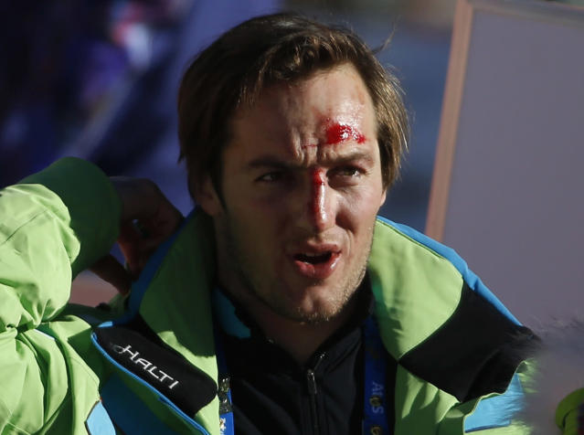 Slovenia's Rok Perko has blood on his face during the third training session for the men's alpine skiing downhill event at the 2014 Sochi Winter Olympics at Rosa Khutor Alpine Center February 8, 2014. REUTERS/Leonhard Foeger (RUSSIA - Tags: OLYMPICS SPORT SKIING)