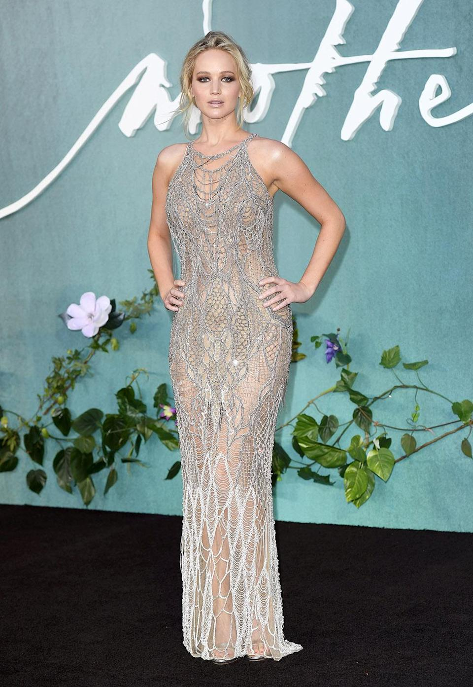 The <em>Silver Linings Playbook</em> star wore a silver Versace dress. (Photo by Karwai Tang/WireImage)