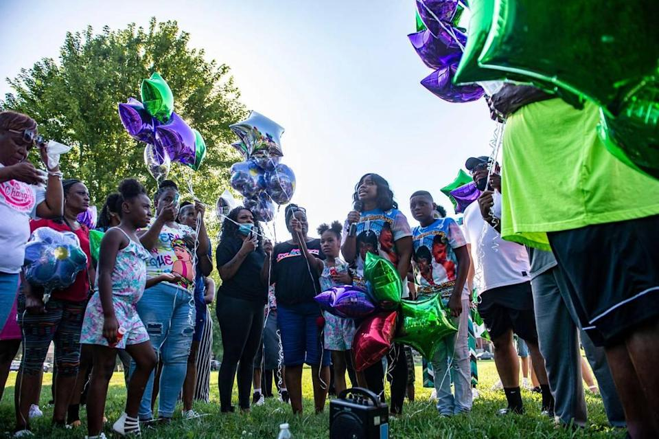 Quiana Martin speaks about the life of her mother, Shirley Muhammad during the vigil to celebrate her life and the lives of Jaelin Ransom and Tyla Ransom, Thursday, July 29, 2021 at Stanford Brown Park in Kansas City. Friends and family gathered to let go of balloons and celebrate their loved ones lives.