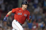 Boston Red Sox's Bobby Dalbec runs after hitting a two-run double in the sixth inning of a baseball game against the Houston Astros at Fenway Park, Thursday, June 10, 2021, in Boston. (AP Photo/Elise Amendola)