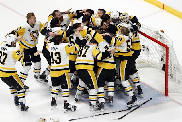 <p>Pittsburgh Penguins players celebrate after defeating the Nashville Predators Game 6 of the 2017 Stanley Cup Final at Bridgestone Arena. Credit: Aaron Doster-USA TODAY Sports </p>