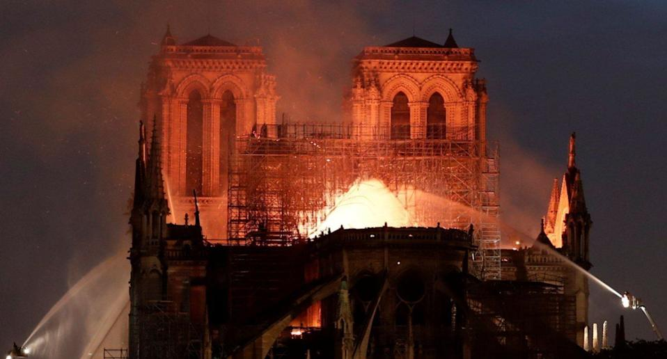 Firefighters douse flames from the burning Notre Dame Cathedral in Paris (Reuters)