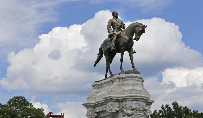 FILE - This Tuesday June 27, 2017 file photo shows the statue of Confederate General Robert E. Lee that stands in the middle of a traffic circle on Monument Avenue in Richmond, Va. Virginia Gov. Ralph Northam is expected to announce plans Thursday, June 4, 2020 for the removal of an iconic statue of Confederate Gen. Robert E. Lee from Richmond's prominent Monument Avenue. (AP Photo/Steve Helber, file)