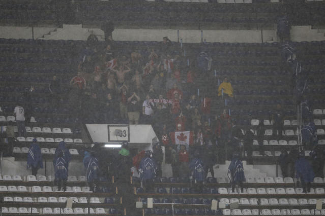 Fans of Canada's Toronto FC celebrate after advancing to the CONCACAF Champions League soccer final in Mexico City, Tuesday, April 10, 2018. The teams tied 1-1 and Toronto FC advanced on aggregate. (AP Photo/Eduardo Verdugo)