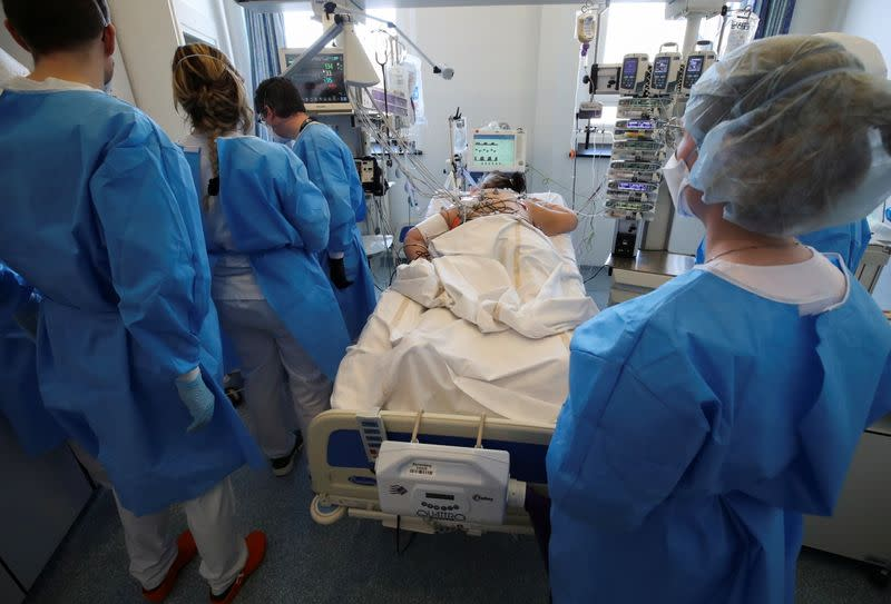 Members of the medical personnel work with a patient suffering from the coronavirus disease (COVID-19) at the intensive care unit at ZNA Stuivenberg hospital in Antwerp