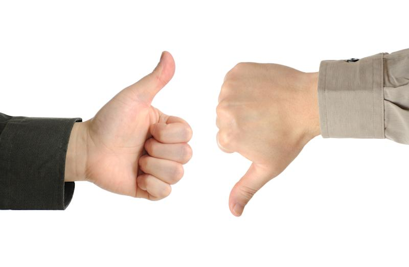 Two hands clad in different types of business-casual sleeves giving thumbs-up and thumbs-down signs.