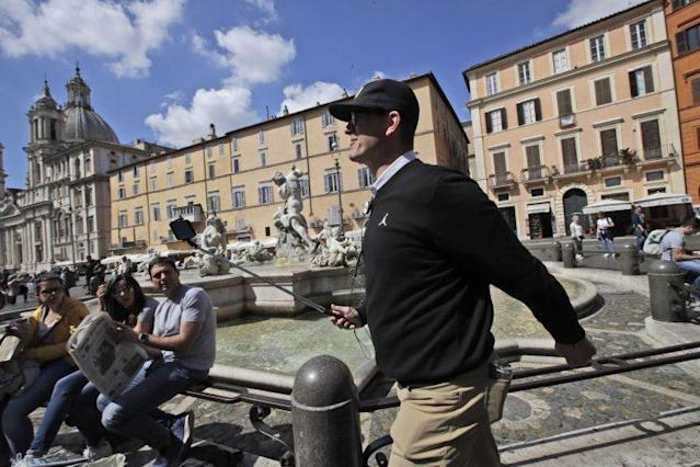 Jim Harbaugh already took his Michigan team to Italy. Now the team has other European destinations in mind. (AP Photo/Alessandra Tarantino)