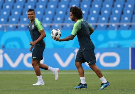 Soccer Football - World Cup - Brazil Training - Rostov Arena, Rostov-on-Don, Russia - June 16, 2018 Brazil's Marcelo with team mates during training REUTERS/Marko Djurica
