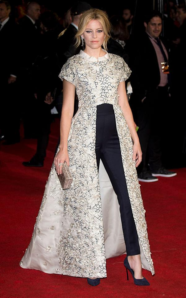 <p>Banks picked the perfect bold look for <em>The Hunger Games: Mockingjay Part 2</em> U.K. premiere on Nov. 5, 2015, in London. Her embroidered dress coat paired with navy trousers looked like an outfit straight out of the film. Her metallic Edie Parker clutch and diamond statement earrings went well with the detailing on the coat. <em>(Photo: Getty Images)</em> </p>