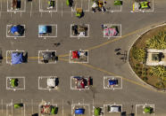 Rectangles designed to help prevent the spread of the coronavirus by encouraging social distancing line a city-sanctioned homeless encampment at San Francisco's Civic Center on May 21, 2020. (AP Photo/Noah Berger)