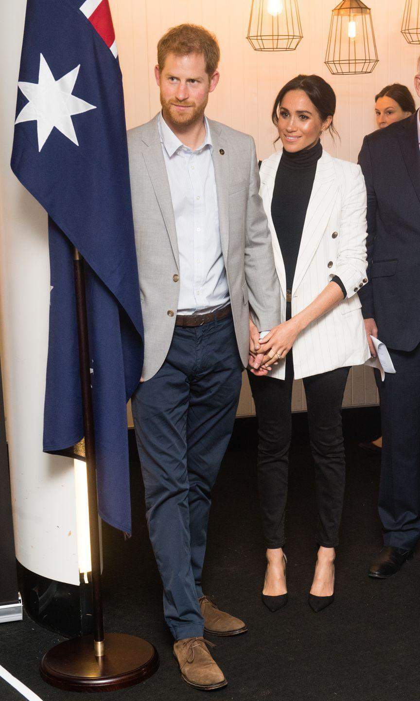 <p>The Duchess can be seen cradling her husband's hands in hers whilst at a lunchtime reception hosted by the Prime Minister of Australia at the Pavilion Restaurant in Sydney.</p>