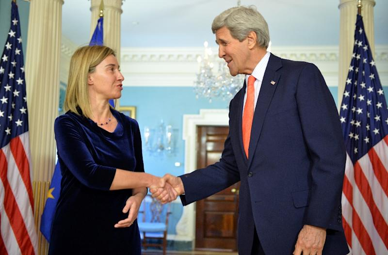 US Secretary of State John Kerry (R) greets EU High Representative Federica Mogherini at the State Department on April 29, 2014 in Washington, DC (AFP Photo/Mladen Antonov)