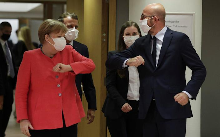 Angela Merkel greets European Council President Charles Michel with an elbow bump, followed by Emmanuel Macron and Finland's Sanna Marin - EPA