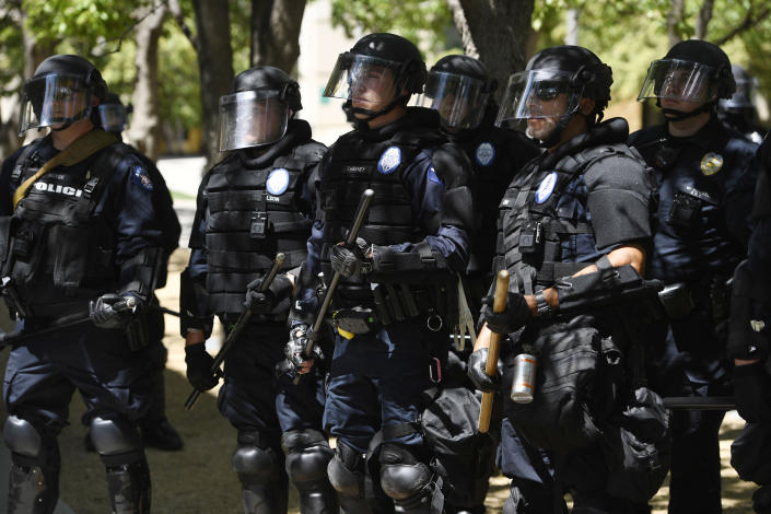 Aurora police in full riot gear at the ready behind a police fence during a Elijah McClain protest in front of the Aurora Police department's headquarters at the Aurora Municipal Center June 27, 2020. (Andy Cross/The Denver Post via Getty Images)