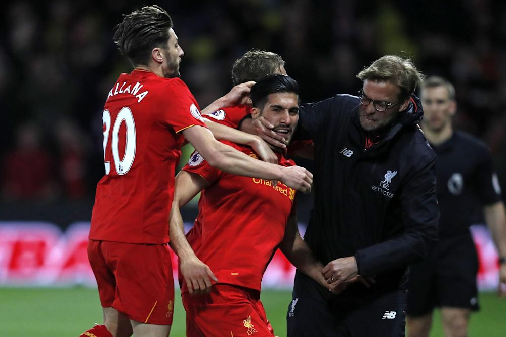 Jurgen Klopp celebrates with Emre Can after the player's stunning goal: Getty