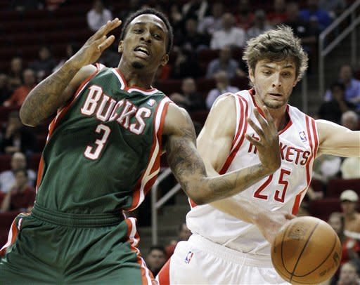 Milwaukee Bucks' Brandon Jennings (3) loses the ball on a steal from Houston Rockets' Chandler Parsons (25) in the first half of an NBA basketball game, Wednesday, Jan. 25, 2012, in Houston. (AP Photo/Pat Sullivan)