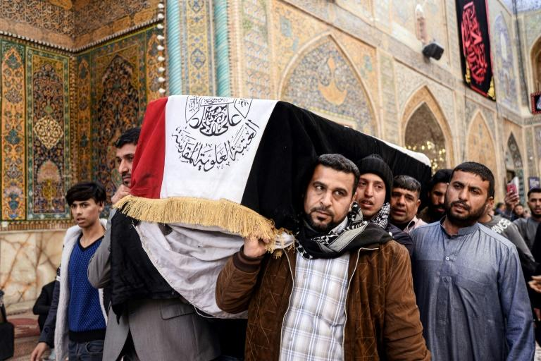 Mourners carry the coffin of a protester killed at an anti-government sit-in in Nasiriyah, during his funeral in the central Iraqi holy shrine city of Najaf