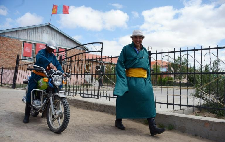 Villagers leave a polling station after voting in parliamentary elections in Mandalgovi, in Mongolia's middle Gobi province on June 29, 2016