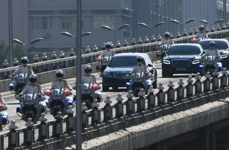 The motorcade believed to be carrying North Korean leader Kim Jong Un is escorted through Beijing
