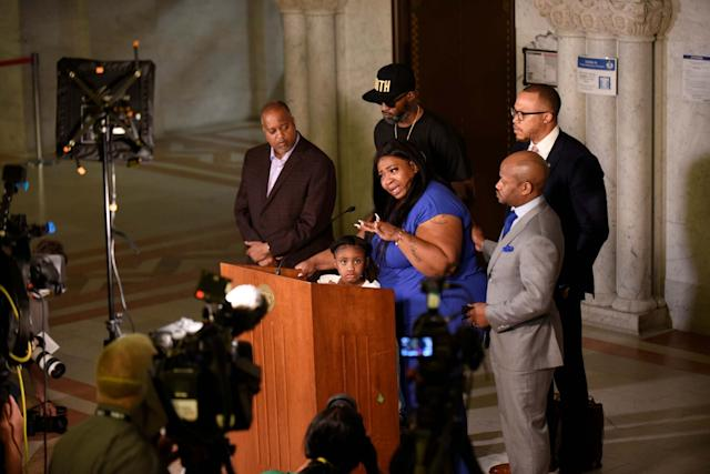 Roxie Washington, the mother of Geroge Floyd's 6-year-old daughter Gianna Floyd, addresses the press alongside her and their lawyers, at Minneapolis City Hall: Reuters