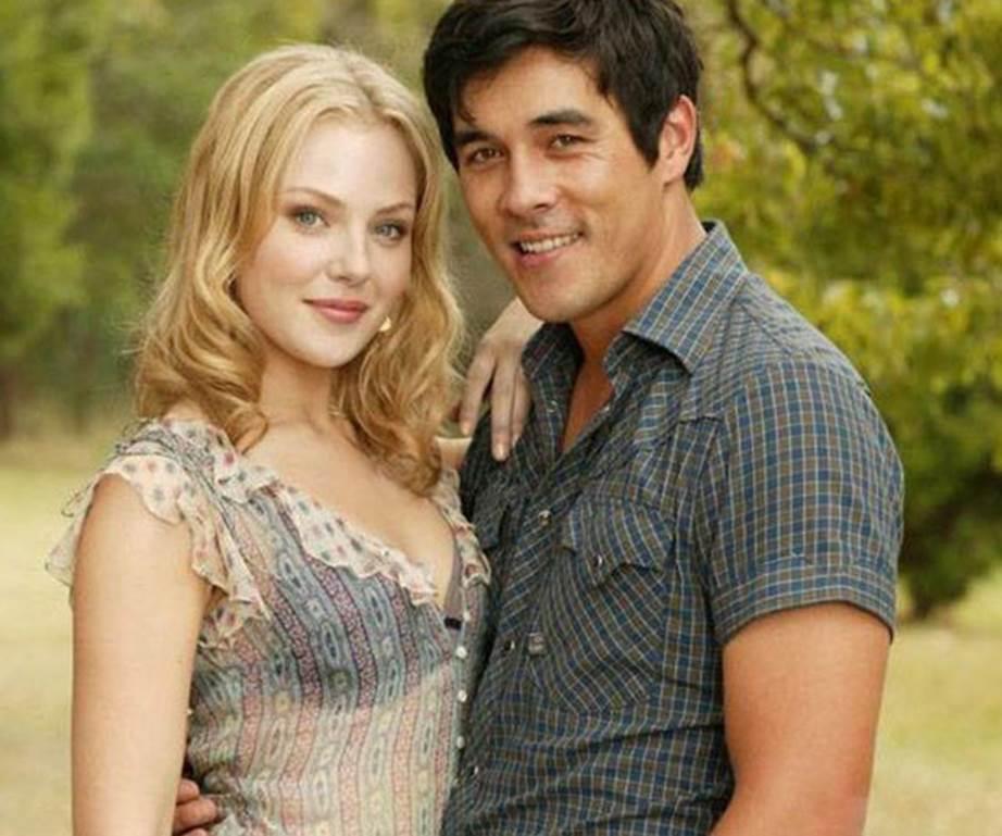 A photo of Packed To The Rafters cast members Jessica Marais (Rachel Rafter) and James Stewart (Jake Barton).