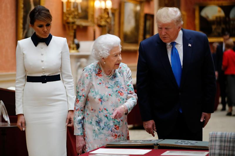(Left to right) First Lady Melania Trump, Queen Elizabeth II with US President Donald Trump view a special exhibition in the Picture Gallery of items from the Royal Collection of historical significance to the US, following a private lunch at Buckingham Palace in London, on day one of his three day state visit to the UK.