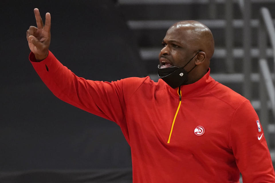 Atlanta Hawks head coach Nate McMillan calls a play against the Toronto Raptors during the second half of an NBA basketball game Tuesday, April 13, 2021, in Tampa, Fla. (AP Photo/Chris O'Meara)