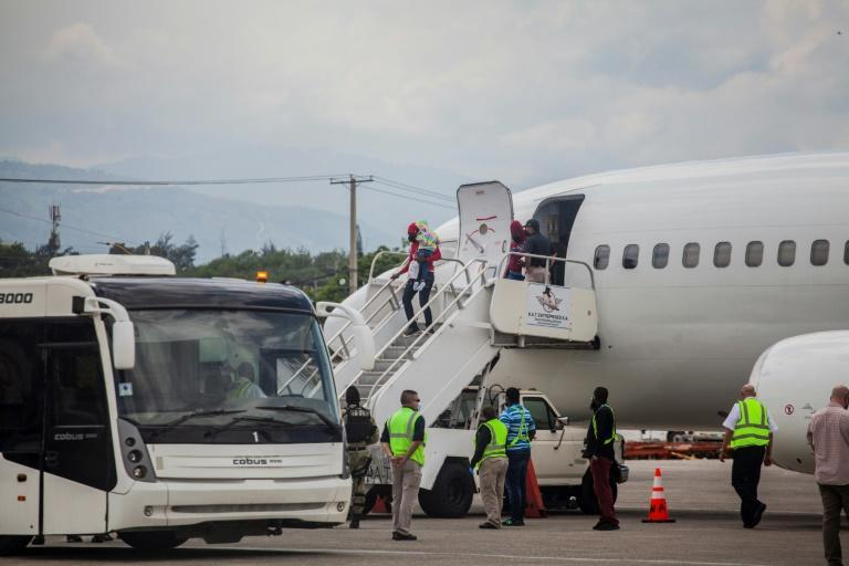 Deported Haitian migrants arrive at the Port-au-Prince airport on September 19, 2021 (AFP/Richard Pierrin)