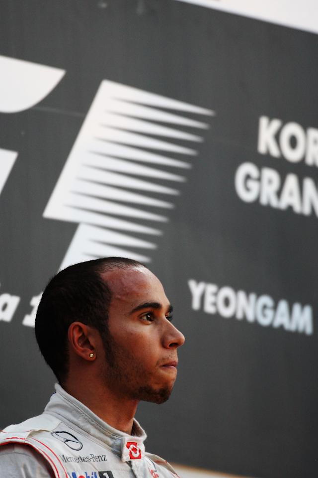 YEONGAM-GUN, SOUTH KOREA - OCTOBER 16:  Lewis Hamilton of Great Britain and McLaren reacts on the podium after finishing second during the Korean Formula One Grand Prix at the Korea International Circuit on October 16, 2011 in Yeongam-gun, South Korea.  (Photo by Ker Robertson/Getty Images)